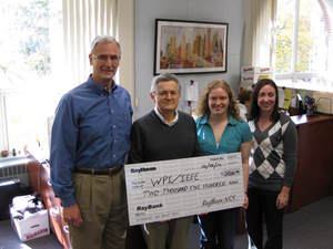 Jim McGrath from Raytheon presents a $2500 check to Prof. Emanuel and Karen Anundson, Co-President of IEEE