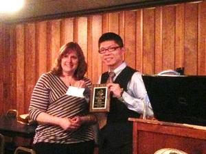 Jane LaGoy presenting award to Xiang Chen