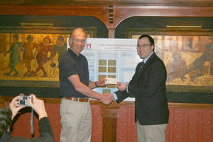 David Sodeberg, ASM- Worcester Chapter, congratulates Erik Khzouz, as he accepts his prize.