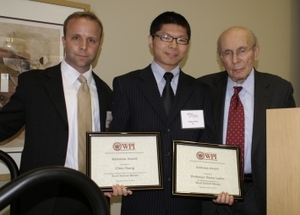 Xiang Chen accepting award on behalf of Professor Diana Lados with Dan Young (right) and David Wolf of Wolf Greenfield & Sacks, P.C.