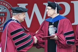 Professor Cyganski, right, receives the Chairman's Prize from WPI President Dennis Berkey.