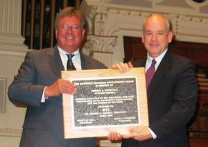 David Forsberg, presents the Bowditch Award to WPI President and CEO Dennis Berkey.