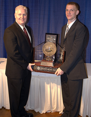 WPI men's basketball head coach Chris Bartley and senior Ryan Cain with the 2007 Jostens Trophy. Photo by Ryan Coleman, D3sports.com.
