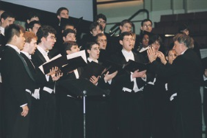 Curran conducts the Glee Club during a performance at Mechanics Hall in Worcester.