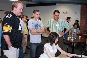 Curt Schilling checks out a video game created by a WPI student.