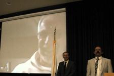 From left, Peter Christopher (on screen),  Provost John Orr, and John Goulet, last year's outstanding teacher.
