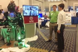 WPI's Atlas team leader Matt DeDonato (left) with the humanoid robot at the Sm