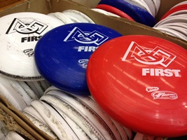 The challenge calls for robots to fling Frisbees into goals of varying heights and sizes.