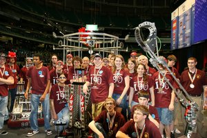 The WPI/Mass Academy FIRST Robotics team in the Georgia Dome with the championship trophy.