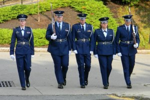 Cadet Timothy Grupp (second from left) at a retreat ceremony on the WPI campus.
