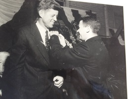 U.S. Sen. John F. Kennedy receives a pledge pin from WPI fraternity Phi Kappa Theta (then Theta Kappa Phi) President Donald Ferrari on Oct. 2, 1958, at the Worcester Armory.