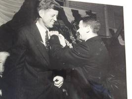 U.S. Sen. John F. Kennedy receives a pledge pin from WPI fraternity Phi Kappa Theta (then Theta Kappa Phi) President Donald Ferrari on Oct. 2, 1958, at the Worcester Armory.