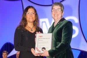 Lados, left, receives the Brimacombe Medal from TMS president Elizabeth Holm.