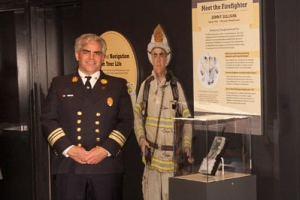 Worcester Deputy Chief Sullivan and his photo in the Smithsonian exhibit. WPI's technology is at right.
