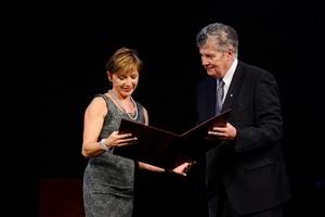 Tanja Dominko receives the Slovenian Ambassador of Science Award from Tadej Bajd, vice president of the Slovenian Academy of Sciences and Arts.