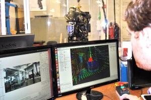 Team leader Matt DeDonato prepares WPI's WARNER robot for a disaster response demonstration.