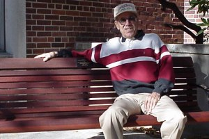 Wagner outside Goddard Hall on a bench dedicated to him during a 2001 tribute dinner.