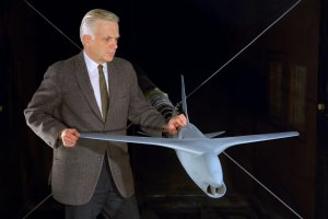 Whitcomb in 1970 with a model used in wind tunnel tests of his supercritical wing innovation.