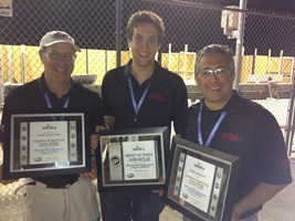 (From Left), WPI professor Michael Gennert, team leader Matt DeDonato and WPI professor Taskin Padir display awards outside at the Speedway.