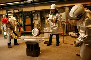 Students at work in WPI's metal casting laboratory.