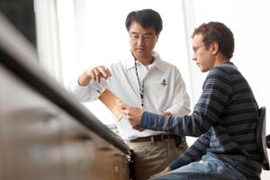Ki Chon, left, in his lab with PhD candidate Christopher Scully.