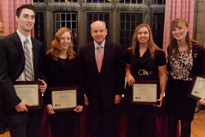 From left, Samuel J. Kesseli, Caitlin E. Butler, WPI President Dennis D. Berkey, Valerie A. Boutin, and Mary C. McCorry.