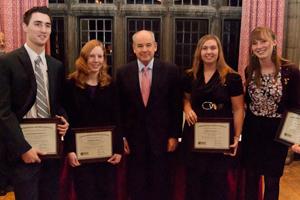 From left, Samuel J. Kesseli, Caitlin E. Butler, WPI President Dennis D. Berkey, Valerie A. Boutin, and Mary C. McCorry.