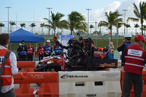 WPI's WARNER humanoid robot drives along the Homestead-Miami Speedway.