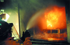 A fire test is conducted in WPI's current fire sciences laboratory in the Higgins Laboratories building.