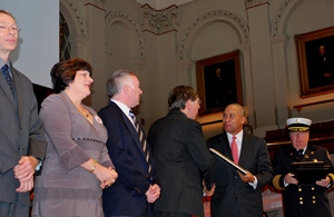 From left, John Orr, Kathy Notarianni, James Duckworth and David Cyganski accept the Fire Marshal's Award from Governor Patrick.
