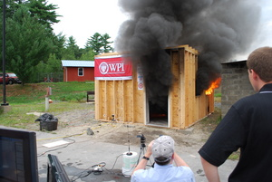 WPI researchers monitor a test of a new flashover detector.