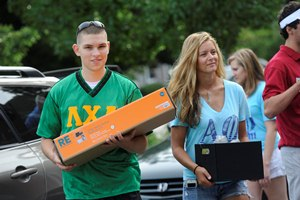 WPI fraternity and sorority members help carry student belongings to residence halls recently during move-in day.