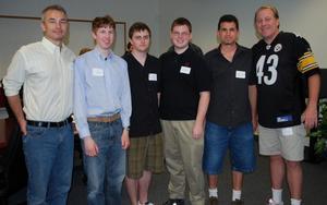 "Brett Close, Members of WPI's ""KickBack"" Team and Curt Schilling."