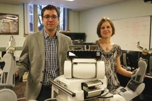 Dmitry Berenson and Sonia Chernova with a PR2 personal robot.