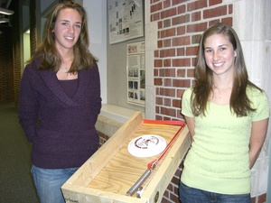 """National Engineers Week video contest winners Lindsay Mullins, left, and Katelyn Perkins, right, stand with their """"Frisbee Launcher"""" project."""