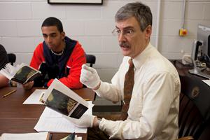 Professor Joel J. Brattin in the Gordon Library archives teaching students about Dickens and serialized fiction.